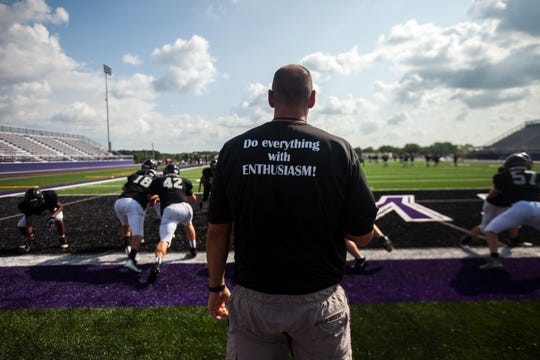 Liberty football head coach Jeff Gordon watches players run drills during a varsity football practice on Friday, Aug. 17, 2018, at Liberty High School in North Liberty. Liberty will travel to City High for their first game in program history on Friday, Aug. 24.