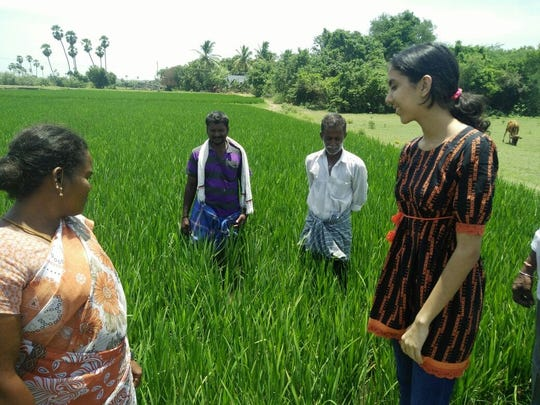 Amishi Nayar (right) helped educate village farmers on irrigation practices.