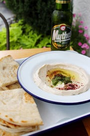 Hummus served with pita or veggies is on the menu at Aplόs.