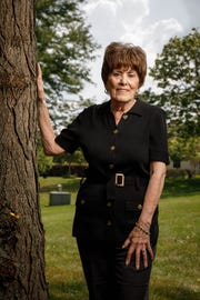 Joan Brody poses for a photo outside of her Chicago-area suburban home Aug. 19, 2018.