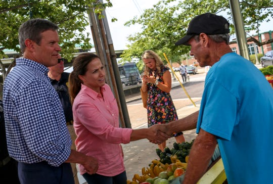 Mike Whitten of Jared Farms speaks to Republican gubernatorial candidate Bill Lee and his wife, Maria Lee, during a campaign stop at West Tennessee Farmer's Market in Jackson on Wednesday, Aug. 22, 2018.
