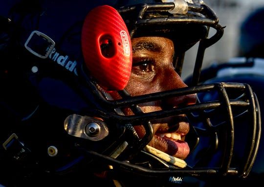 South Side's Jamarion Burks (52) watches his teammates play from the sidelines during a scrimmage game against University School of Jackson that they would later win 14-7 at USJ in Jackson, Tenn., on Friday, Aug. 3, 2018.