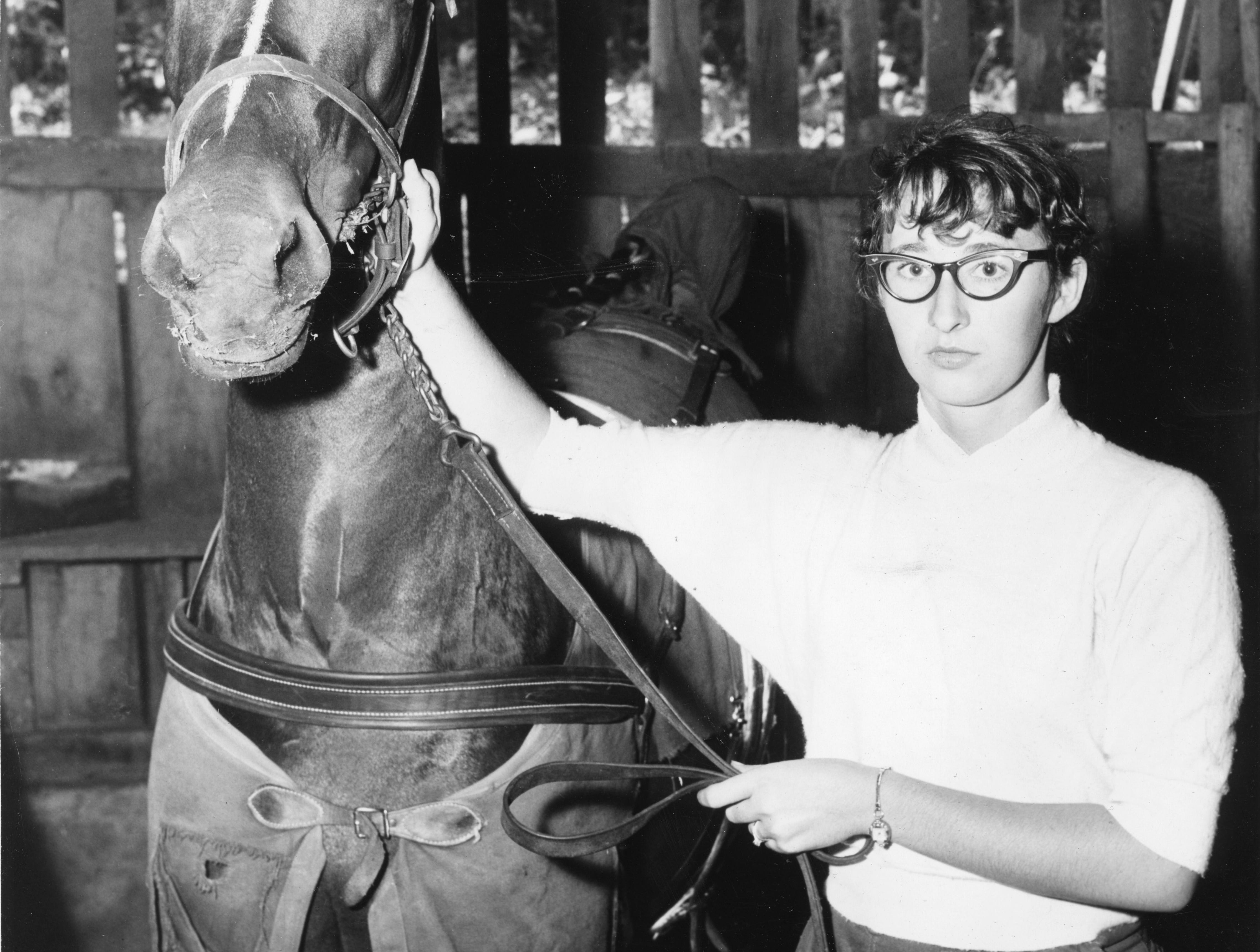 Mrs. J. B. Borden, of Maryville, and her horse Rockee's Glory, at the Tennessee Valley Fair on September 13, 1956.