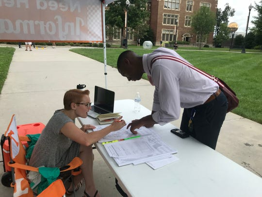 UT Knoxville senior James Lytle maps out part of campus with Lindsey Snow, coordinator of new student and family programs. Snow was stationed near Ayres Hall on the first day of classes to help students find their way.