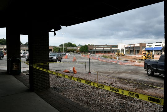 View from the front of Western Plaza Barber Shop on Wednesday, August 22, 2018. Businesses are suffering from unusually long construction times in their parking lot.