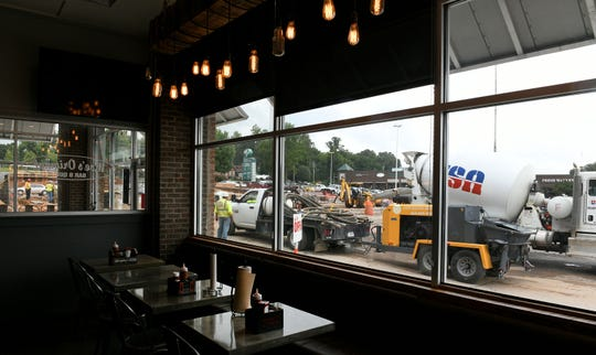 It is very difficult for customers of Moe's Original Bar B Que in Western Plaza to get into the building due to an unusually long construction period in their parking lot Wednesday, August 22, 2018.