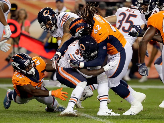 Denver Broncos linebacker A.J. Johnson (62) stops Bears running back Taquan Mizzell (33) as linebacker Josey Jewell (47) pursues during the second half of a preseason NFL football game, Saturday, Aug. 18, 2018, in Denver.