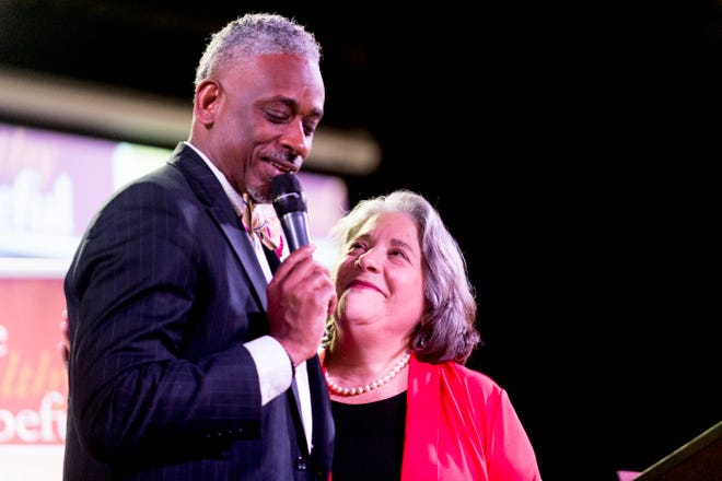 Knoxville Mayor Madeline Rogero hugs Daryl Arnold, pastor of Overcoming Believers Church, during the Cities United conference in Knoxville on Aug. 22.