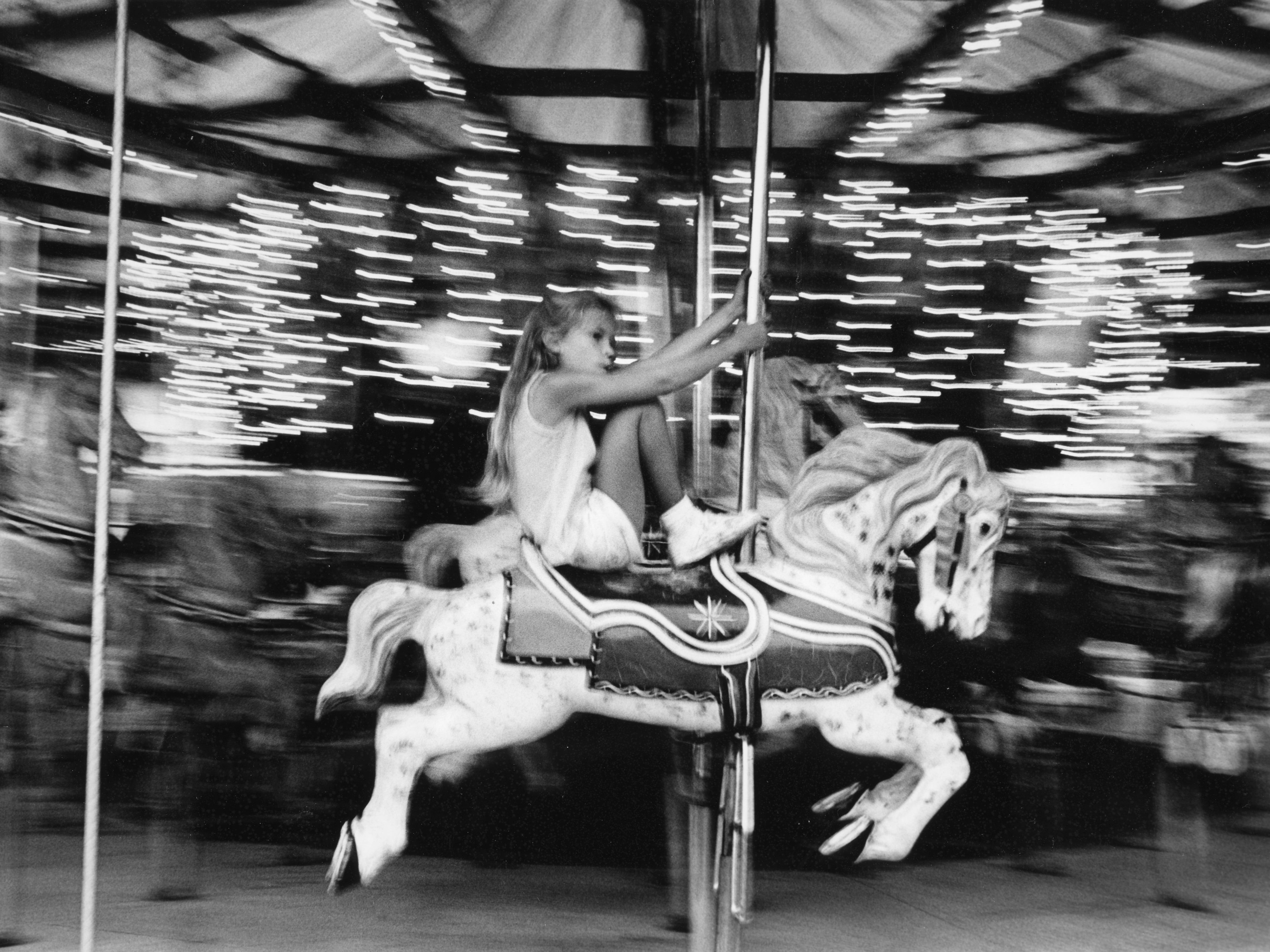 Stephanie Humphrey, 7, rides the merry-go-round at the Tennessee Valley Fair in 1988.