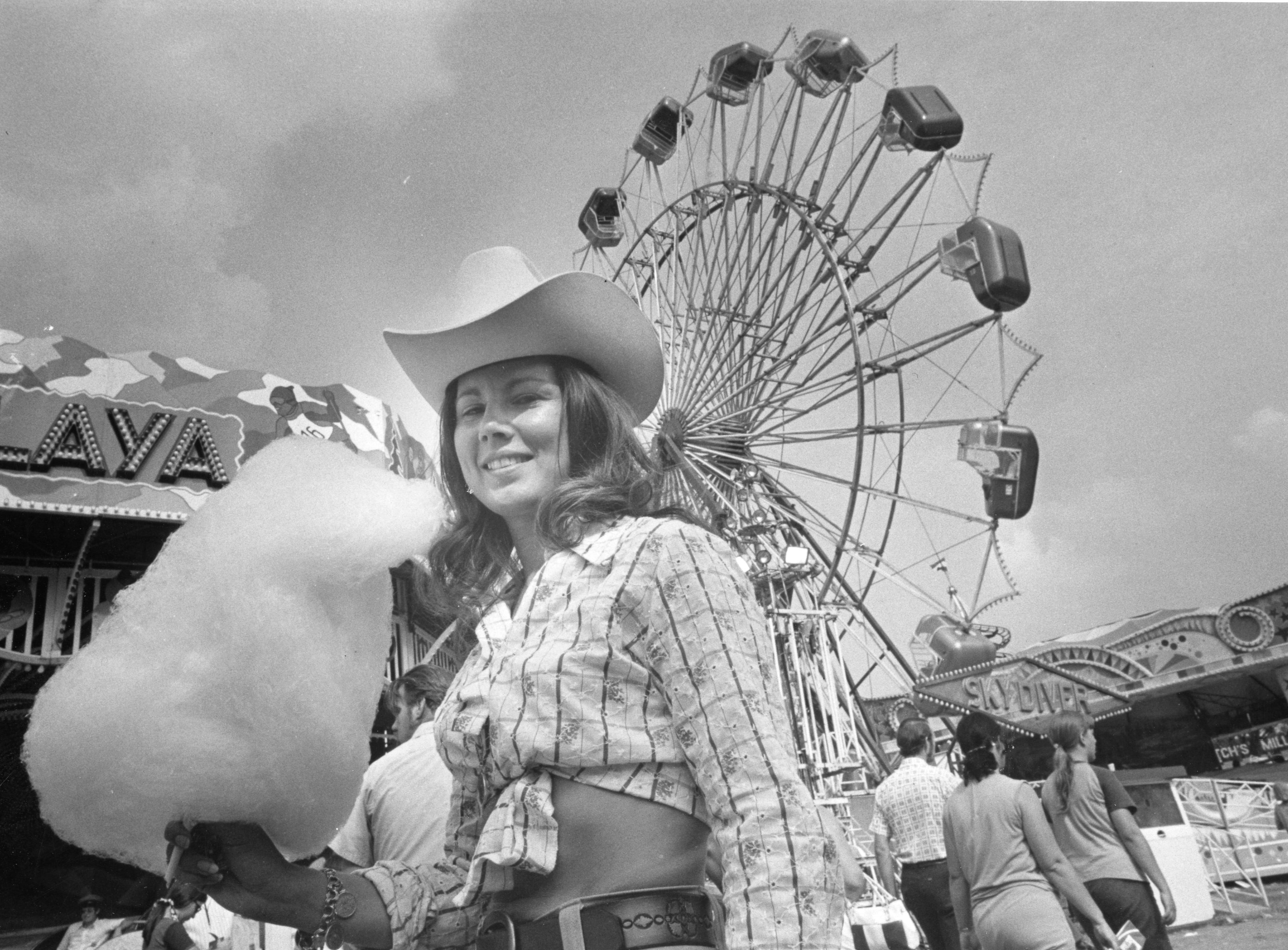 Diane Whitt holds her cotton candy at the Tennessee Valley Fair on September 9, 1973.