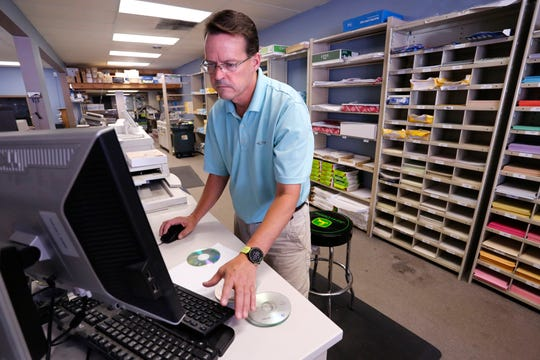 Richard Abrahamson works on a copy order at Copymat in Chauncey Hill Mall Wednesday, August 22, 2018, in West Lafayette. Copymat has been located in Chauncey Hill Mall for over 30 years. Abrahamson, who is manager of the store, says he has no idea where the business will relocate to with the development of The District at Chauncey Hill.