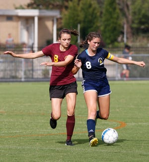 Emma Bullock of Central Catholic works to keep the ball away from Julie Timperman of Faith Christian Tuesday, August 21, 2018, in Lafayette. CC defeated Faith 7-1 behind the hat trick of Karsyn Cherry.
