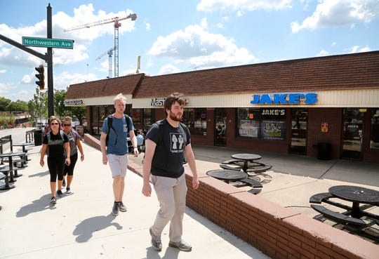Students walk past Jake's Roadhouse, which recently closed its doors, Wednesday, August 22, 2018, in the Chauncey Hill Mall in West Lafayette.