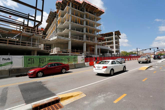 Traffic along State Street passes the construction site of Hub Plus and The Rise at Chauncey, two new retail/housing developments, Wednesday, August 22, 2018, in West Lafayette. Hub Plus is located just east of the Chauncey Hill Mall.