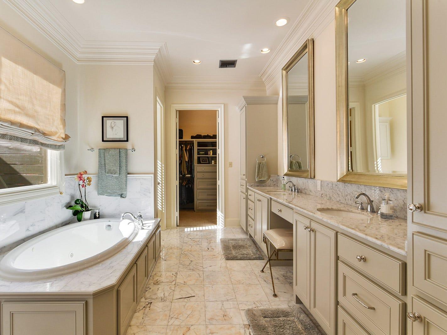 The master bath is a spa-like retreat.