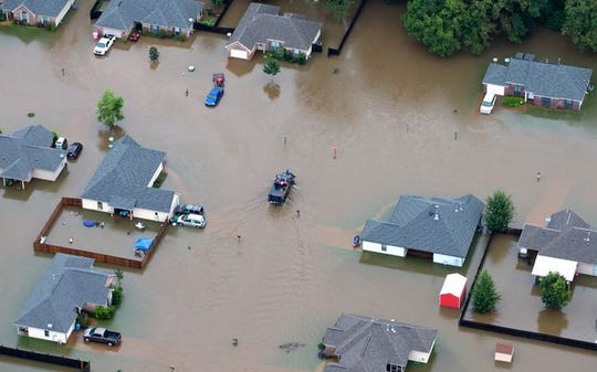 An aerial photo shows a Youngsville neighborhood under water during the 2016 Louisiana flood.