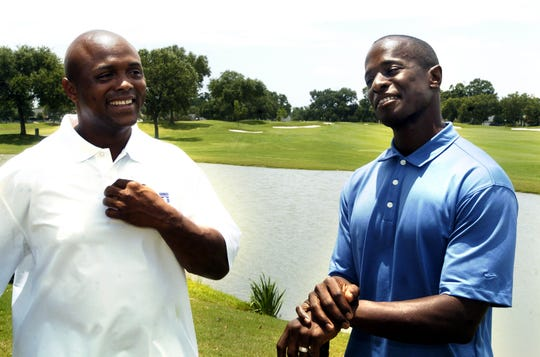 Former UL quarterback Donnie Wallace, shown here enjoying time on the golf course with another Cajun quarterback Brian Mitchell, relishes the opportunity his son Deuce has this season to extend the family's legacy with the UL Ragin' Cajuns.