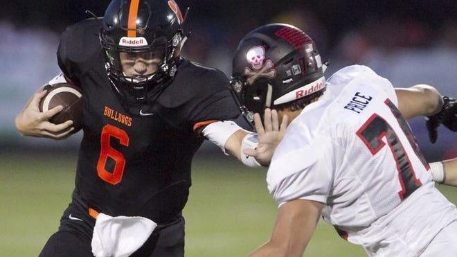 Pinckney's Jacob Price (right) pursues Brighton quarterback Will Jontz.