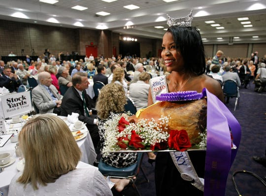 Miss Kentucky Djuan Trent shows off the grand champion ham for bidders at the 2010 Kentucky Country Ham Breakfast. The ham sold for a then-record $1.6 million.