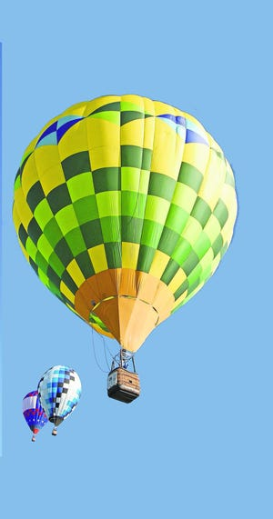 Nearly two dozen hot-air balloons will be in the air Friday and Saturday as part of the Greater Lansing Balloon Festival at the Hope Sports Complex in Holt.
