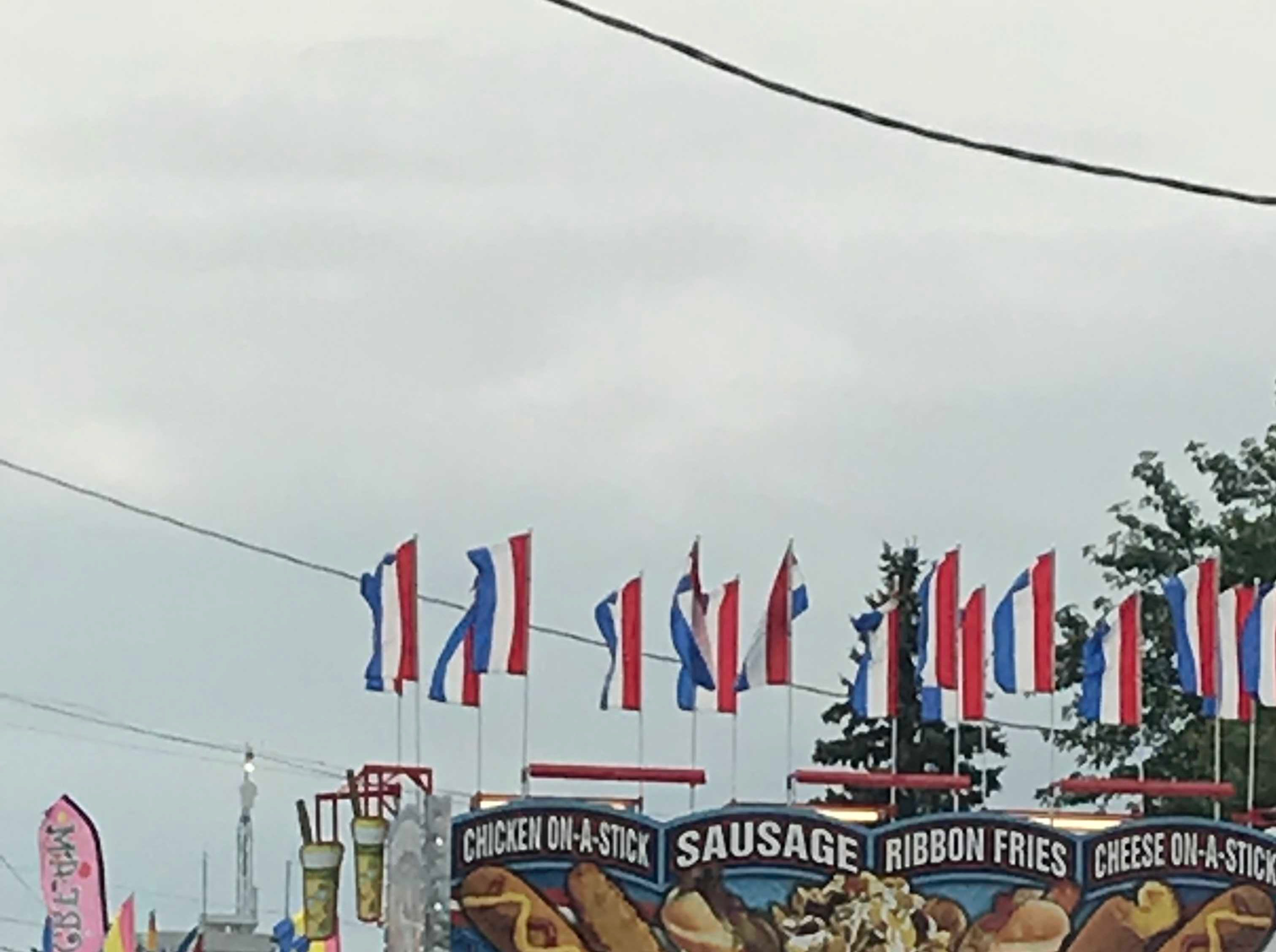 Vendors open their windows as the Manitowoc County Fair opens on its first night Tuesday.
