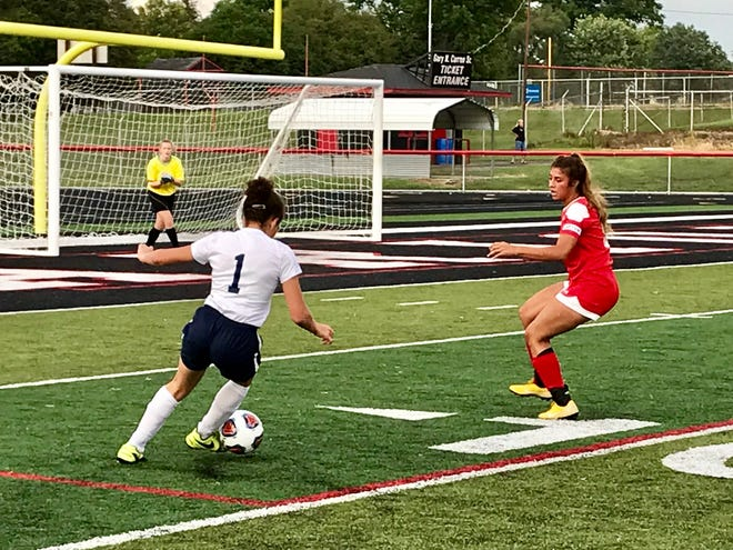River Valley's Tatyana Young (1) dribbles the ball toward the goal with Marion Harding's Olivia Moodley and keeper Parkar Maul defending. River Valley won the opener 5-0.