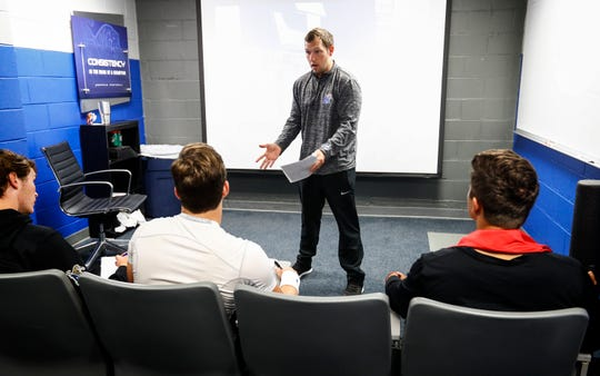University of Memphis first-time offensive coordinator Kenny Dillingham holds a quarterbacks meeting before practice. At 28-years-old, Dillingham is one of the youngest offensive coordinators in college football.