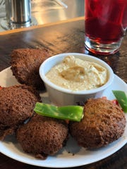 Sudanese falafel with hummus is served at Global Cafe in Crosstown Concourse.
