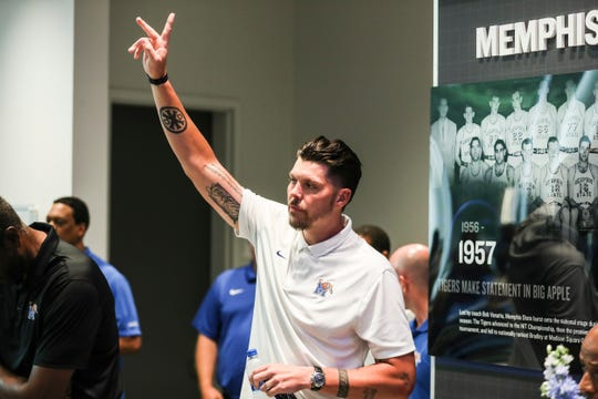 Tigers assistant Mike Miller, shown at the Memphis Rebounders annual preseason banquet Aug. 21, is called the more lively of the two former teammates.