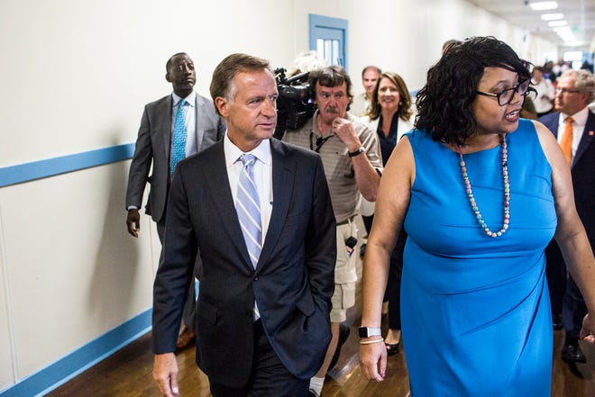 Governor Bill Haslam, left, takes a tour of Georgian Hills Achievement Elementary School along with Principal Yolanda Dandridge in August. The school was closed for three weeks due to heating issues during a cold snap.