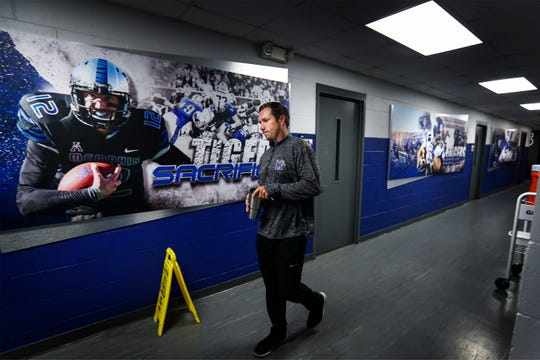University of Memphis first-time offensive coordinator Kenny Dillingham enters the football practice facility before 6 a.m. to prepare for the upcoming day. At 28-years-old, Dillingham is one of the youngest offensive coordinators in college football.