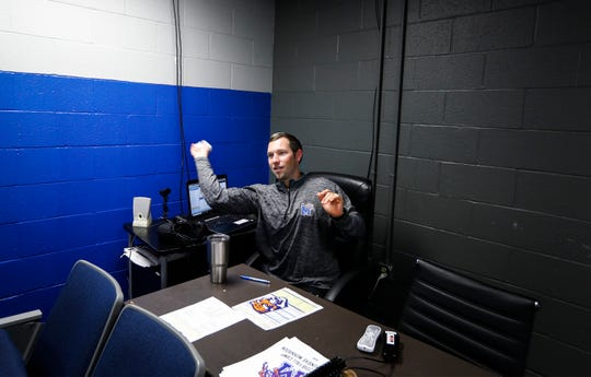 University of Memphis first-time offensive coordinator Kenny Dillingham jokingly comments on his throwing accuracy while tossing a piece of paper into a trash can. At 28-years-old, Dillingham is one of the youngest offensive coordinators in college football.