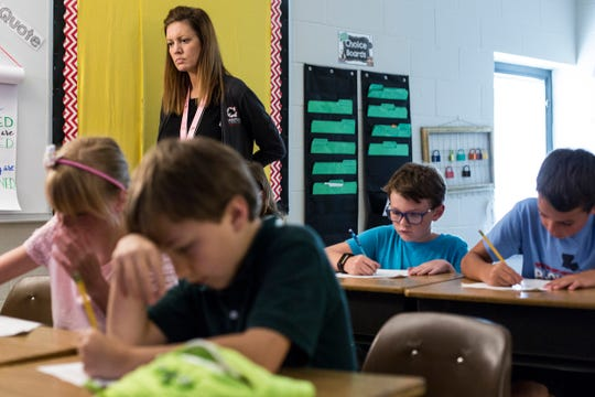 Instructional coach Jennifer Ledford watch as students work in fourth grade class at Dogwood Elementary in Germantown.