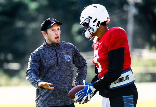 University of Memphis first-time offensive coordinator Kenny Dillingham (left) chats with starting quarterback Brady While during a recent practice. At 28-years-old, Dillingham is one of the youngest offensive coordinators in college football.