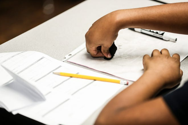 A student works in class during a visit by then-Governor Bill Haslam to Achievement School District school Georgian Hills Achievement Elementary School on Wednesday, August 22, 2018.