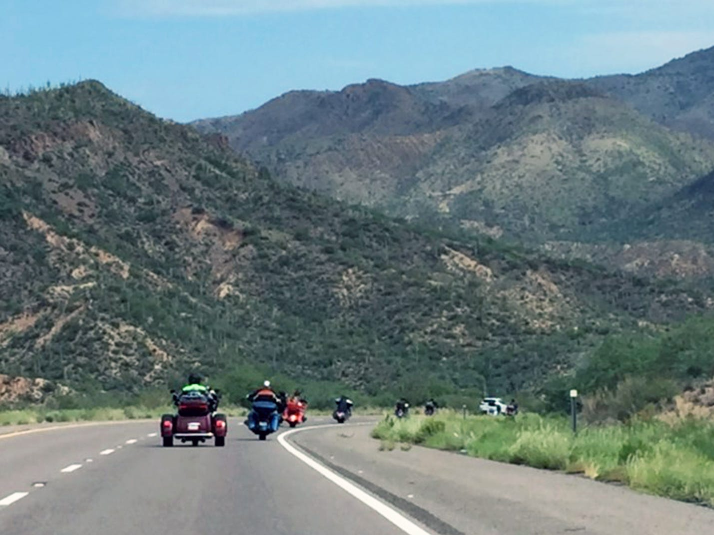 Thirty bikes joined Day 2 of the nine-day Harley-Davidson 115th anniversary ride between San Diego and Milwaukee. Two of the riders were Karen Davidson and Bill Davidson, great-grandchildren of co-founder William Davidson. This photo was taken in the Tonto National Forest between Scottsdale and Payson, Arizona.