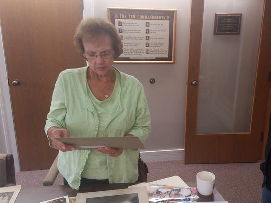 Joan Schaetzel looks over old photos and records from the 175-year history of St. John UCC in Germantown.
