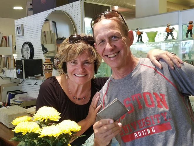Steve Hiniker visits Jaruska Karbulka's antique store in Racine, where she returned the wallet he lost while biking across the Czech Republic in May. She also was visiting her native Czech Republic in May and was asked by a store owner there to track down Hiniker, who lives in Madison.