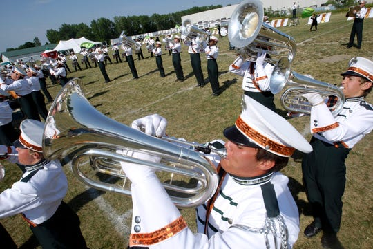 Pioneer Drum & Bugle Corps and Color Guard members including Evan Zinc (foreground) perform during the 50th-anniversary gathering on July 9, 2011, in Cudahy.