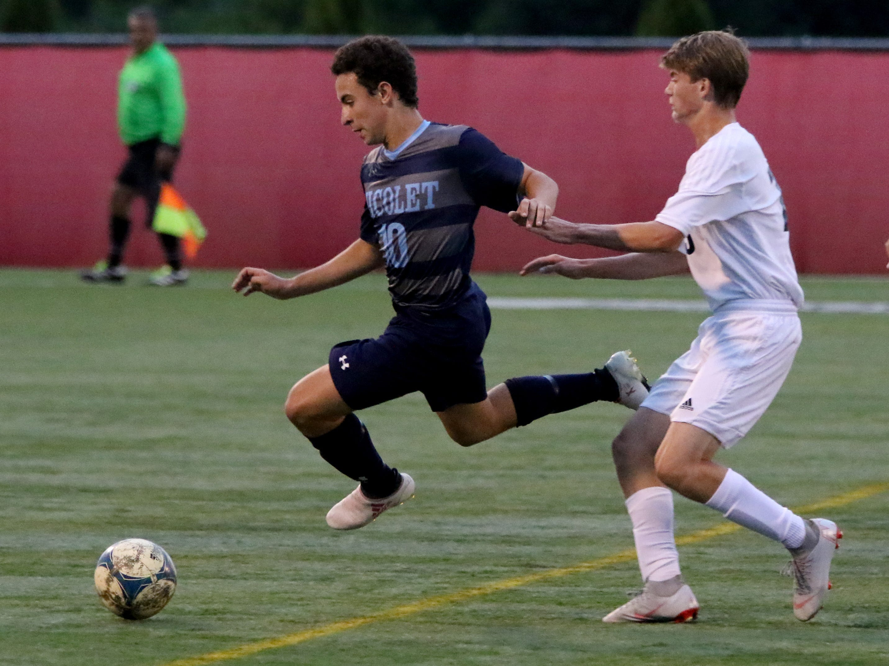 Nicolet's Eric Perlin controls the ball from Lake Country Lutheran's Garrett Lueth at Uihlein Soccer Park on Aug. 21.