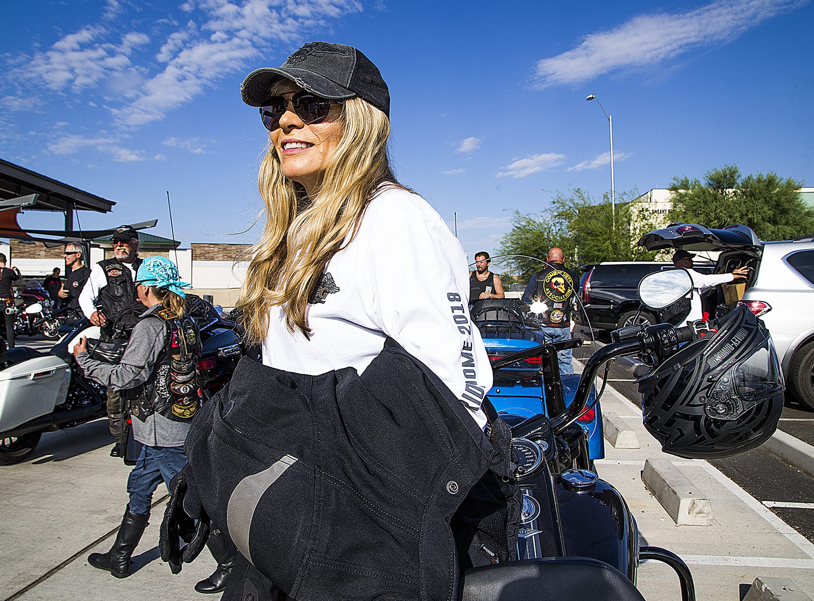 Karen Davidson, creative director of general merchandise for Harley-Davidson Motorcycles, gets ready to ride her 2019 Road King Special outside the Harley-Davidson dealership in Scottsdale, Arizona, Aug. 22.  Davidson is the great-granddaughter of Harley-Davidson co-founder William A. Davidson.