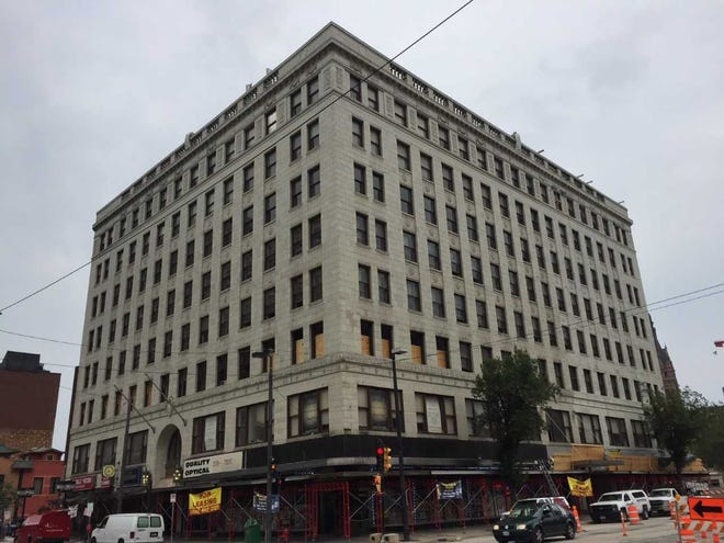 Four of the Century Building's eight floors are being converted into apartments, which will open in September.
