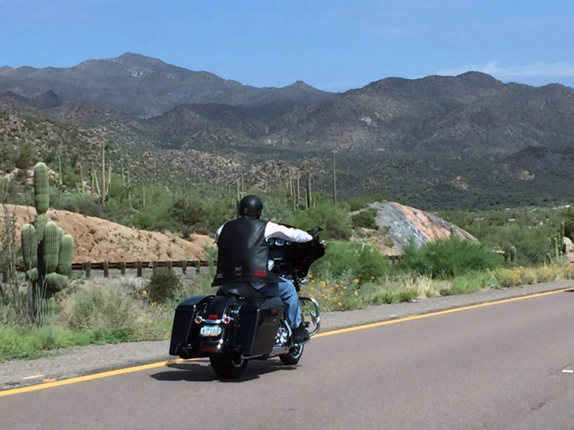 A rider passes through the Tonto National Forest after leaving Scottsdale on Day 2 of ride from San Diego to Milwaukee. About 30 bikes left Scottsdale at 9 a.m.