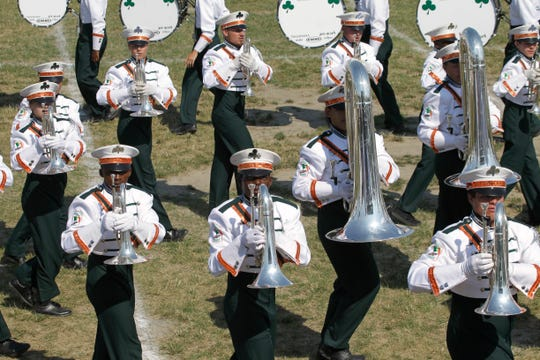 Members of the Pioneer Drum & Bugle Corps and Color Guard perform during the 50th-anniversary gathering for alumni and current members in 2011 in Cudahy.