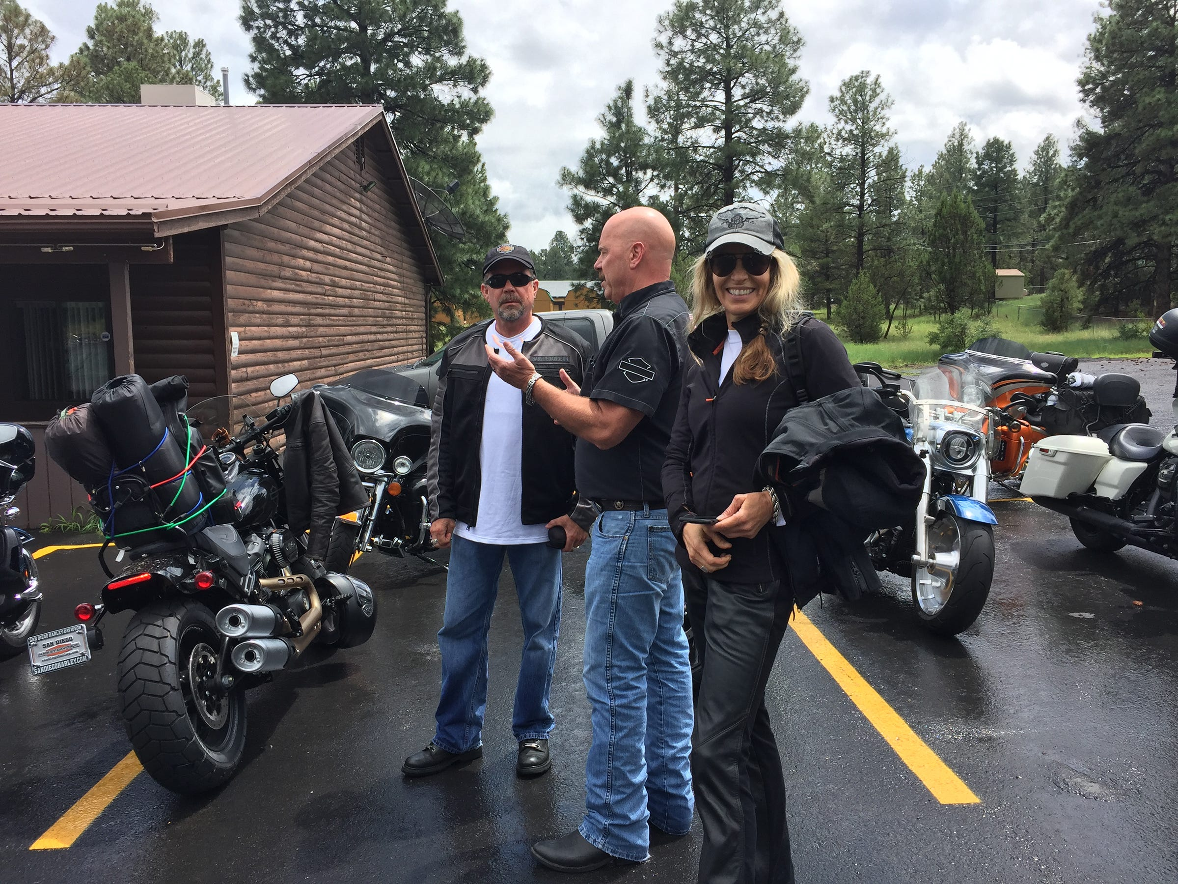 Bill Davidson, Karen Davidson and Glenn Dusz talk outside the Red Onion Lounge in Overgaard, Arizona, where riders stopped for lunch. Glenn recommended the Green Chile Burger.