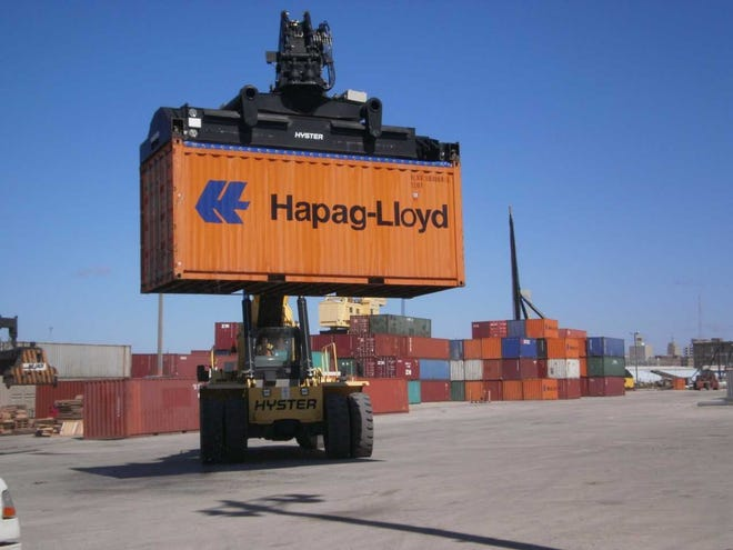 A shipping container is transferred between rail and truck at the former intermodal cargo terminal at Port Milwaukee. Efforts to re-establish the terminal are gaining momentum, thanks in part to the increase in freight expected from Foxconn Technology Group.