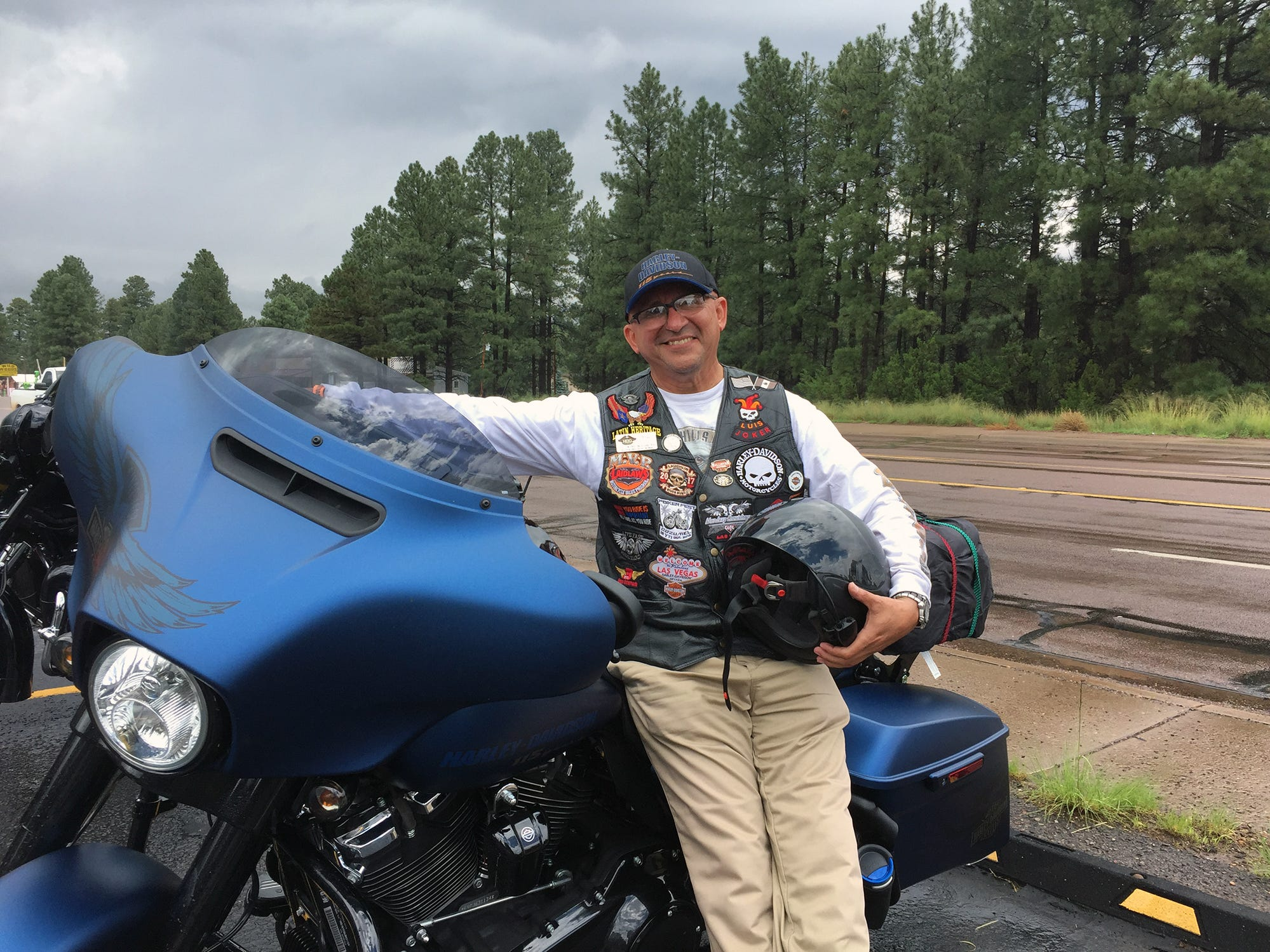 "Luis Burgos, 56, of Anaheim, joined the Southwest Harley-Davidson 115th anniversary trip in Yuma, Arizona. After riding in 112-degree temperatures, he said he was happy to see the clouds come out in Payson, Arizona. ""I don't mind the clouds,"" he said. ""They make me enjoy the ride even more."""