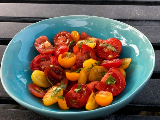 A simple tomato salad brings together summer's best flavors.