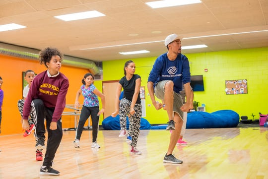 Cedric Gardner works with dancers at the Boys & Girls Club. The team, called the Davis Dancers, recently won a national hip-hop dance competition.