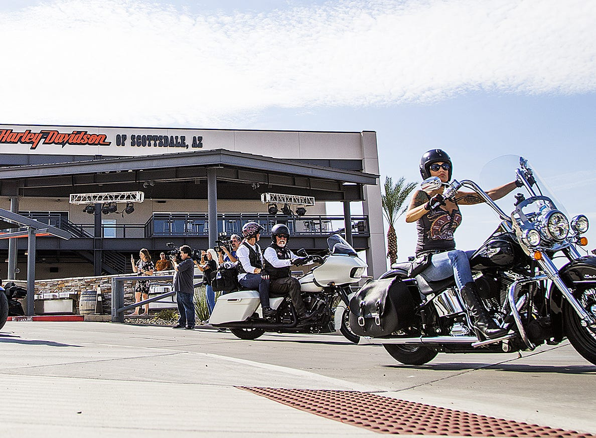 Riders leave the Harley-Davidson dealership.